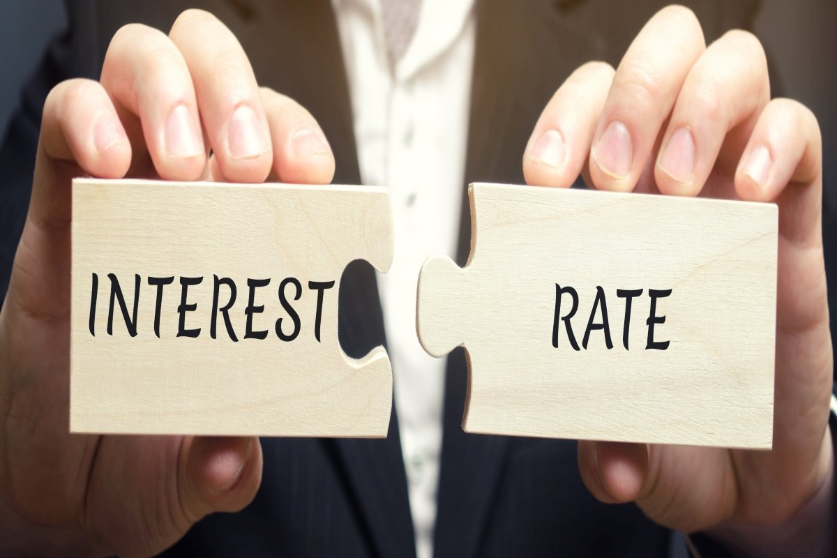 a-man-collects-wooden-puzzles-with-the-word-interest-rate-the-amount-of-money-in-the-form-of-interest_t20_axA04Q