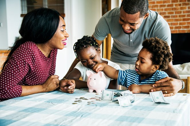 family-saving-money-to-piggy-bank-LUB39RT